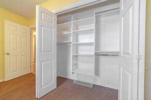 White built in closet or wardrobe interior