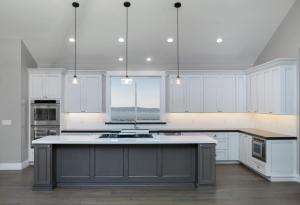 Amazing new contemporary with large white Kitchen with massive kitchen Island and grey counter tops.
