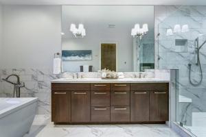 Incredible master bathroom with Carrara marble tile surround.
