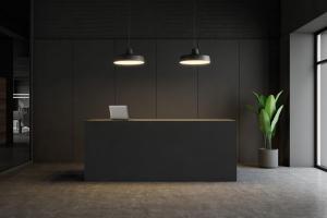 Dark gray reception desk in modern office